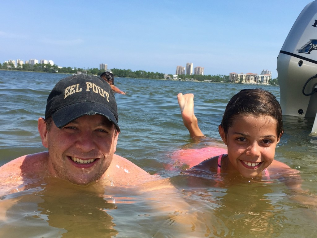 My husband Jim and our niece Isabella hanging out in the water of Perdido Bay.